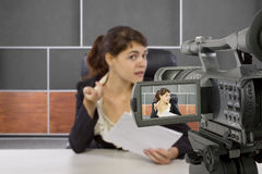 Female Reporter in a Set Stock Image