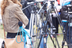 Female reporter waiting for news conference Royalty Free Stock Photo