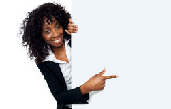 Female representative pointing towards placard Royalty Free Stock Photography