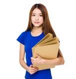 Female representative posing with file folder Stock Image