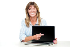 Female representative presenting new laptop Royalty Free Stock Photo
