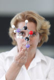 Female Researcher Analyzing A Molecular Structure Stock Image