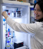 Female researcher carrying out experiment Stock Photography