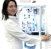 Female researcher carrying out experiment Stock Images