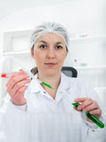 Female researcher with glass equipment in the lab. Royalty Free Stock Image