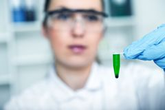 Female researcher with glass equipment in the lab Royalty Free Stock Photography