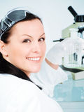 Female researcher holding glass tube Royalty Free Stock Photo