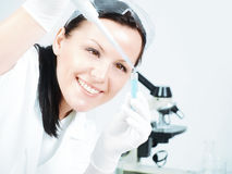 Female researcher holding test tu Royalty Free Stock Images
