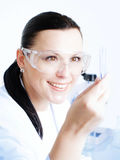 Female researcher holding up a test t Stock Images
