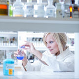 Female researcher holding up a test tube Royalty Free Stock Images