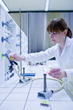 Female researcher lighting up a burner Royalty Free Stock Photography