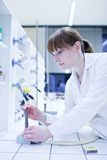 Female researcher lighting up a burner Royalty Free Stock Photo