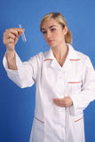 Female researcher with test tube Royalty Free Stock Images