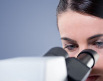 Female researcher using microscope close up Royalty Free Stock Image