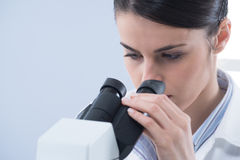 Female researcher using microscope close up Stock Photography