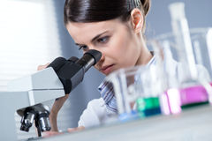 Female researcher using microscope Royalty Free Stock Photos