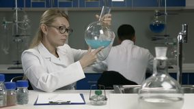 Female researcher working in chemistry lab stock footage