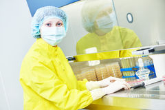 Female researcher working with dangerous hazard virus material Stock Image