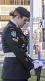 Female reservist vigil. A young female reservist stands vigil at a war memorial in Glace Bay Nova Scotia Canada on Remembrance Day, November 11, 2014. Memorials Royalty Free Stock Photo