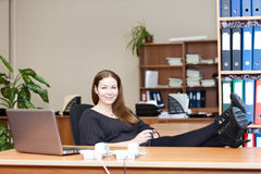 Woman resting with coffee mug on working place Royalty Free Stock Image