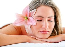 Female resting with flower Stock Photos