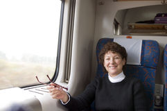 Female retired senior first class train in Poland Royalty Free Stock Photo