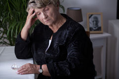 Female retiree being in mourning Royalty Free Stock Photography
