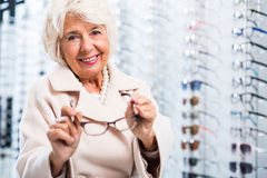 Female retiree in optician store Royalty Free Stock Image