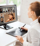 Female retoucher working at home or office Stock Images
