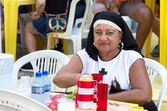 A female reveler with a nun costume at Carnival in Recife, Brazi. Recife, Brazil - February 9th, 2018: Portrait of a woman with a nun costume at the Carnival in Royalty Free Stock Photo