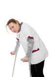 Female revised nurse is limping Royalty Free Stock Photo