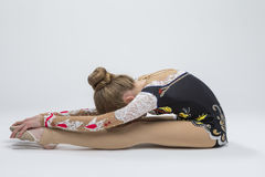 Female Rhythmic Gymnast Athlete In Professional Competitive Suit Doing Backbend Stretching Royalty Free Stock Photography