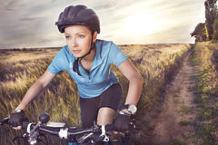 Female rider cycling. On a rural road Stock Photography