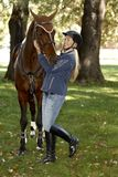 Female rider embracing horse Stock Photo