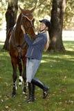 Female rider embracing horse stock photo