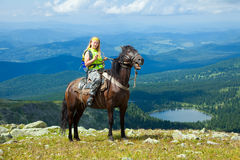 Female rider on horseback Stock Image