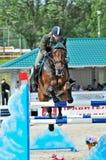 Female rider on jump horse Royalty Free Stock Photo