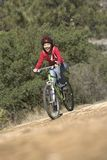 Female Riding Bicycle On Dirt Road Royalty Free Stock Photo
