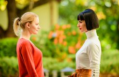 Female rivalry. Friendship problems rivalry and jealousy. Rivalry and leadership. Women looking at each other with. Attention. Blonde brunette competitors royalty free stock images