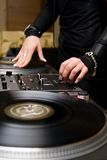 Female rnb deejay playing turntables. Chick spinning the vinyl records in the nightclub Royalty Free Stock Images