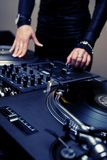 Female rnb deejay playing turntables Royalty Free Stock Photo