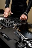 Female rnb deejay playing turntables Royalty Free Stock Image