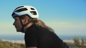 Female road cyclist in the sunset