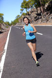 Female road runner training running outdoors Royalty Free Stock Photos