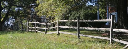 Split Rail Fence in Front of Stately Brick Home royalty free stock photos