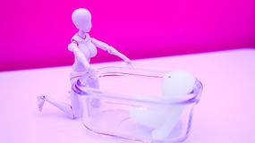 A female robot that takes care of a child in a glass bottle. royalty free stock photography