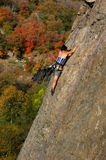 Female rock climber. Woman climbing sport route in fall Stock Photo