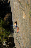 Female rock climber. Woman climbing sport route in fall Royalty Free Stock Image
