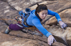 Female rock climber. Stock Image