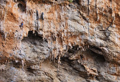 Female rock climber on a cliff face Stock Images